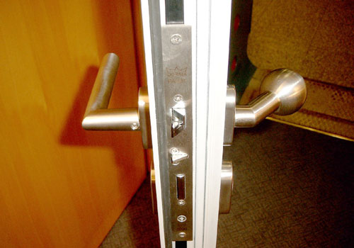 Photo: Front door lock with various security latch techniques